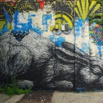 A huge rabbit painted on the wall. New York City -Brooklyn. Street art by Belgian graffiti artist Roa