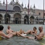 Some even enjoy the flood. Venice during a period of seasonal high water
