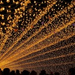 Rays of colorful light illuminate the sky. The world's largest light installation 'Winter light' in Japan
