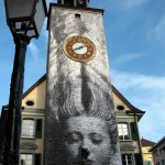 American artist JR takes photos and paste them on buildings around the world.