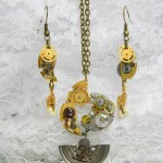 'Heavenly Pendulum'. Ornaments made of clockworks, also used Swarovski crystals and a dark garnet. Suspension is small. The lower part of the pendant moving like a pendulum.