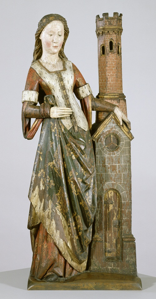 Saint Barbara. The virgin martyr stands by her usual atttibute - the tower with three windows symbolizing her belief in the Trinity. Date between 1450 and 1500