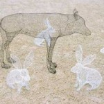 A wolf and hares 3D sculpture
