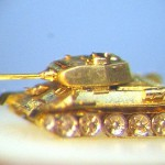 T34-85. located on the longitudinal section of Apple grain. length-2 mm. material-gold 999.9 hallmark