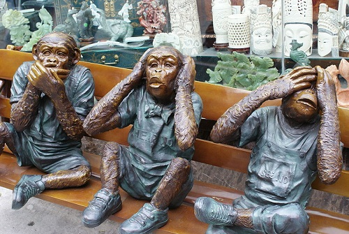 Three monkeys on the bench. Sculpture, San Francisco, United States