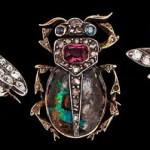 A box of three diamond flies and bug brooches
