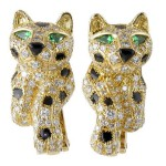Cartier Panther 18K Gold Onyx Diamond Emerald Earrings. France, $35,000