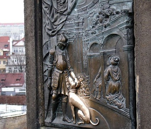 Plaque at the base of the statue of John of Nepomuk on Charles Bridge in Prague