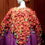 Poncho-jacket with embroidery of bougainvillea, the plant with which the garden is surrounded