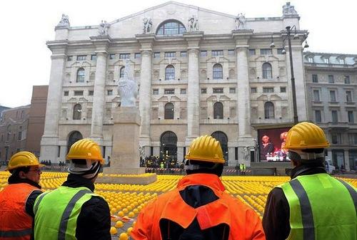 Art installation of yellow helmets protest in Milan