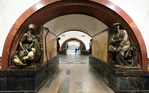 Bronze sculptures by Matvey Manizer at the famous station of the Moscow Metro – Revolution Square station