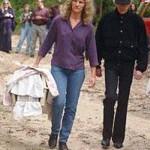 Veterinarian Rachel Blackmer of the Cape Wildlife Center in West Barnstable, accompanied by fashion designer Oleg Cassini