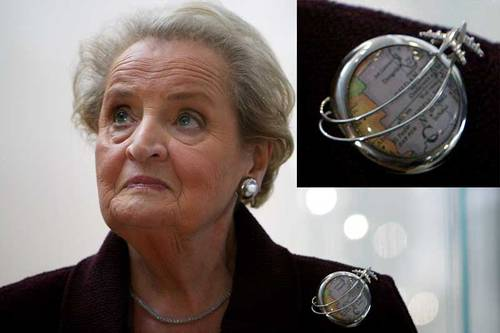 Madeleine Albright, wearing a pin displaying a map of Sudan.