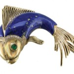 Brooch from Oscar Heyman, 18K yellow gold, diamonds, enamel, emeralds