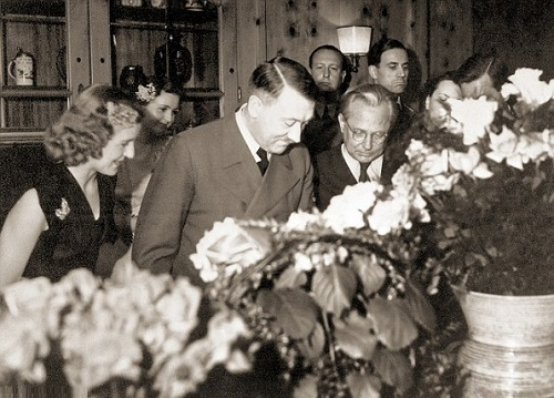 Adolf Hitler with guests at his birthday party at his residence, the Berghof, on April 20, 1943. On the far left is Eva Braun. Behind her is her close friend Herta Schneider