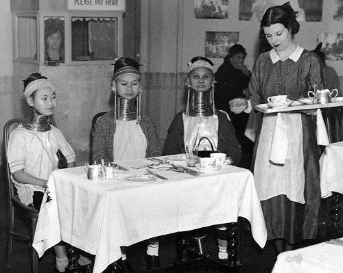 Giraffe necked women of Burma having tea in England, circa 1935. (Photo by General Photographic Agency)