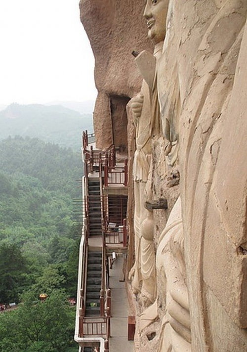 Buddhist complex Maytszishan. Huge statue of Buddha is almost perpendicular to the mountain wall — the highest is more than 16 meters in height.