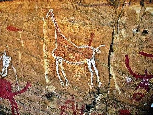 Tadrart Acacus cave paintings date from 12,000 BC to 100 AD depict giraffes, elephants, ostriches and camels, men and horses.