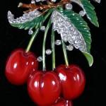 Trifari cherries pin brooch. Deep red and green enamel with rhinestones