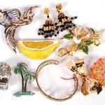 Trifari; gold washed rhinestone bird in flight pin