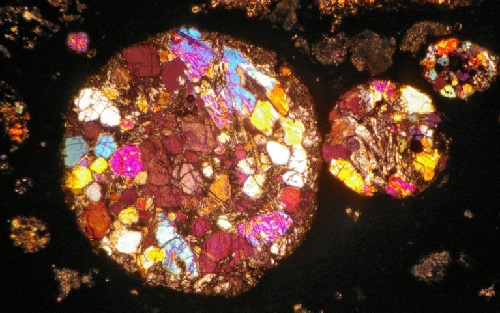 Beautiful saturated image of meteorite that looks like stained-glass window, photograph by Jeff Barton