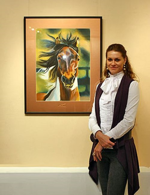 Beautiful Russian artist Viktoria Markelova, at the exhibition of her works