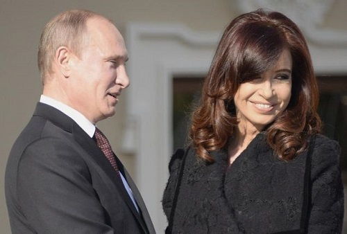 Russian President Vladimir Putin (R) welcomes Argentina President Cristina Fernandez de Kirchner at the start of the G20 summit on September 5, 2013 in Saint Petersburg. Russia hosts the G20 summit hoping to push forward an agenda to stimulate growth but with world leaders distracted by divisions on the prospect of US-led military action in Syria
