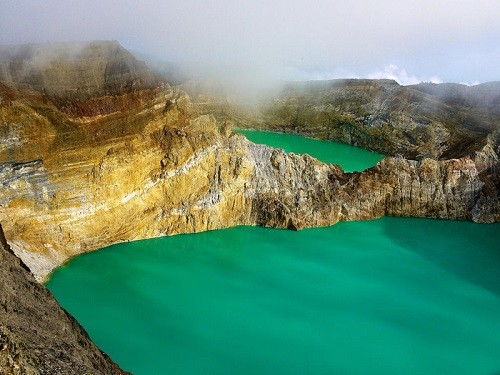 A bright turquoise spot of one of the 3 crater lakes Kelimutu