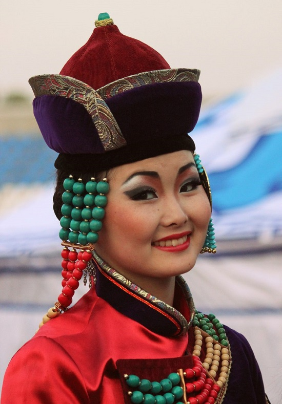 Eastern Buryat woman. Coral jewelry decorate the national costume