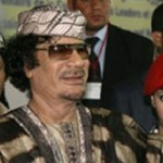 Libyan leader Muammar Gaddafit accompanied by his female elite bodyguards