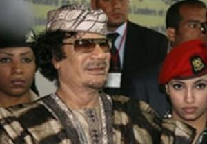 Libyan leader Muammar Gaddafit accompanied by his female elite bodyguards