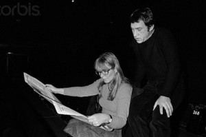 Vladimir Vysotsky and Marina Vlady. French actress Marina Vlady reads a newspaper in the Palais de Chaillot theater with her husband Vladimir Vysotsky, a Russian anti-establishment actor, poet, songwriter and singer, during a rehearsal of Shakespeare's Hamlet, directed by Yuri Lyubimov. Vysotsky plays the lead role. November 17, 1977. Paris, France