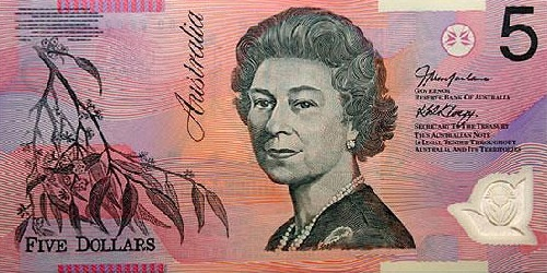 A colorful five dollar Australian note. In 1965, Australia adopted the name 'royal' for its currency, but it was later dropped in favor of the dollar