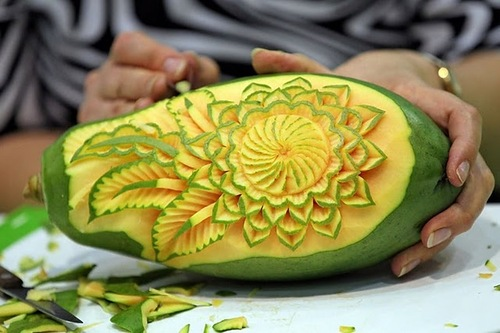 A woman carves a mango on September 5, 2011 during the first European vegetable carving competition in Leipzig, eastern Germany
