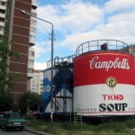 Association of artists from Novosibirsk. The most famous of their work – condensed milk tins and Campbell's soup in Yekaterinburg, made ​​as part of the festival 'Stenografia'