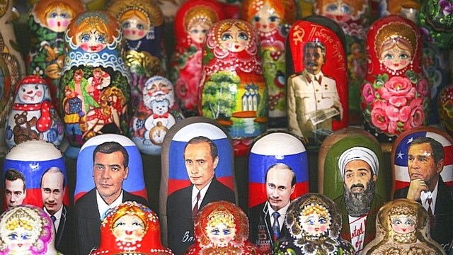 Portraits of Russian presidential candidate Dmitry Medvedev (C) and President Vladimir Putin (R) adorn traditional Russian nesting dolls, matryoshka