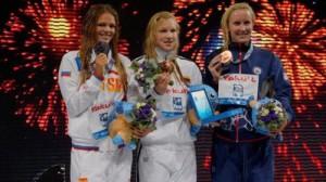 Three winners - Yulia Yefimova, Ruta Meilutyte and Jessica Hardy