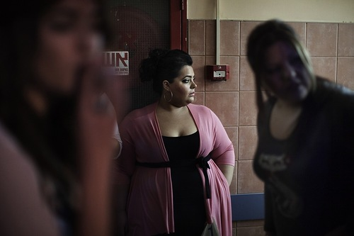 Contestants for a Miss Large beauty pageant wait before entering the dressing room ahead of the contest