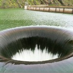 Drain hole in the reservoir of the dam Monticello