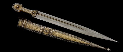Dagger inlaid with precious stones. Kubachi jewelry