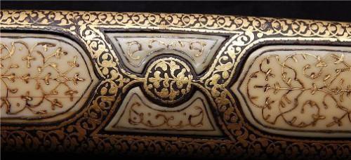 Dagger inlaid with precious stones. Kubachi jewelry