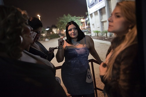 Israel women beauty, FEATURE, by Majeda El BatshTania Weinermann (C) who won the Miss Fat & Beautiful beauty pageant contest smokes before entering the dressing room ahead of the contest