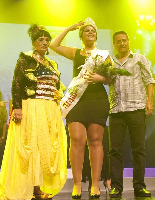 Vered Fisher (Miss Large Beauty winner), centre, stands on stage at the end of the Fat and Beautiful contest held in the southern Israeli town of Beersheva, 2012