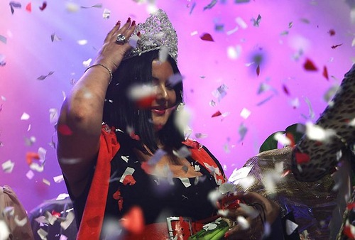 "Russian born beauty, Tanya Vaiman, 23, adjusts her crown after winning the annual ""Fat and Beautiful"" beauty pageant in the southern city of Beersheba January 15, 2011"
