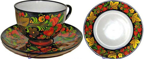 Tea cup and a saucer. Khokhloma painting performed on porcelain