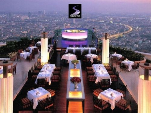"Unusual restaurants. Sirocco is the world's largest all open-air restaurant and ""Sky Bar"", located on the 64th floor of the State Tower in Bangkok, Thailand"