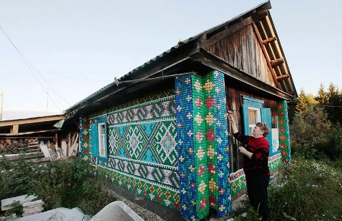 The wooden houses in Russian villages decorated with colorful bottle caps