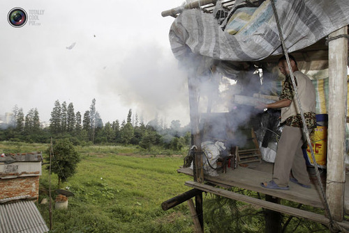 Chinese farmer Yang Youde pushes his homemade cannon