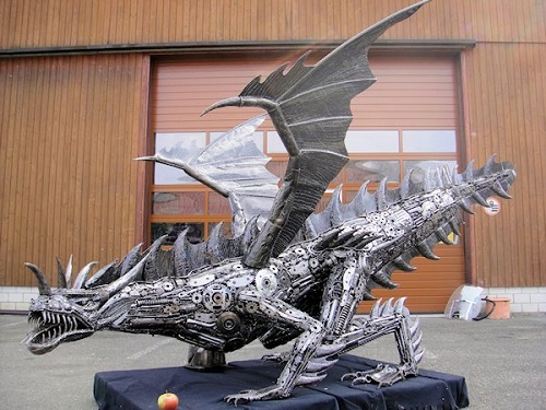 Winged dragon, sculpture made from recycled metal by Tom Samui
