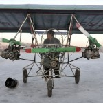 Ding Shilu, an automobile mechanic, sits in his self-made aircraft. It weights about 130 kg (287 lbs) and made of recycled materials including three motorbike engines and plastic cloth, cost about 2600 yuan ($395)